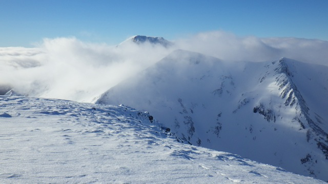 Carn Mor Dearg and Ben Nevis poking out above the cloud.