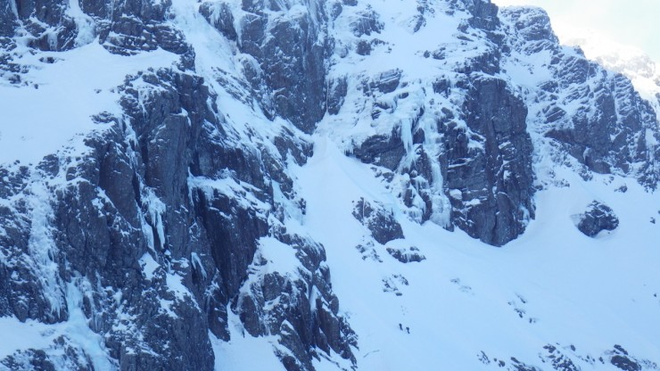 Climbers heading up to a route in the Trident Buttress area. Plenty of ice about.