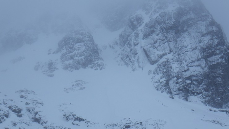 The bottom of Number 5 gully with two climbers heading over to the base of the curtain.