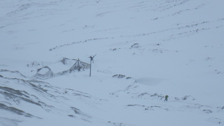 A lone walker above the hut.