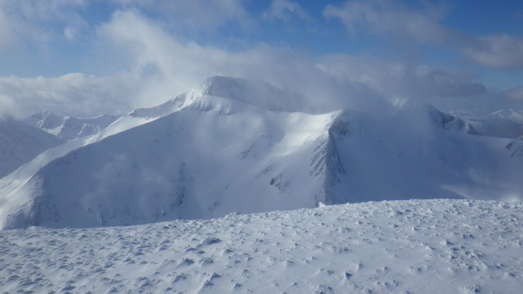 View from Aonach Mor plateau to Carn Mor Dearg and Ben Nevis behind.