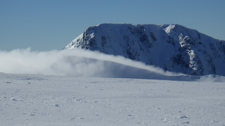 Looking towards the Ben with some people on Carn Mor Dearg ridge in the cloud