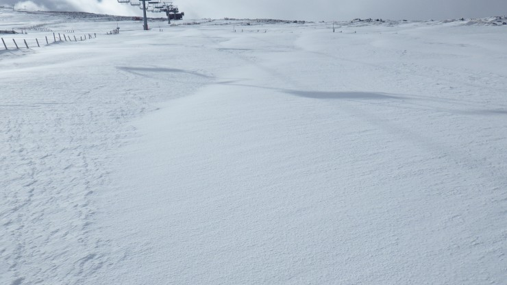 Clear contrast between scoured old snow (on left) and the recent windslab