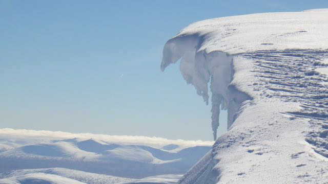 Large cornices may collapse as the weather warms in the next few days.