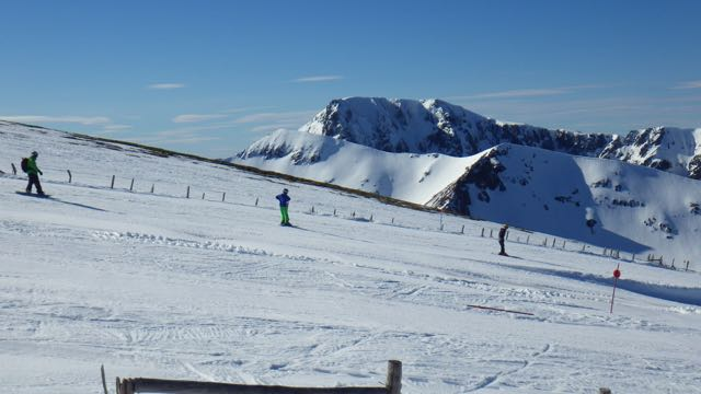 Skiing and boarding at Nevis Range with Ben Nevis behind.