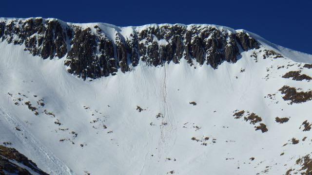 Cornice collapse and snow dropping off warming rock in Coire an Lochan.