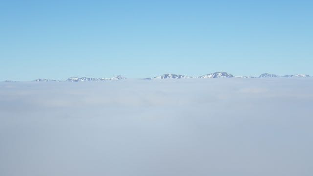 Higher summits were visible above the cloud layer.