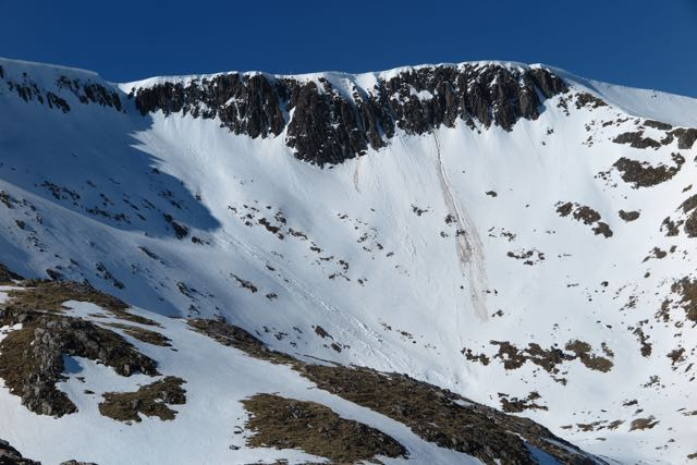 Coire an Lochan showing debris trails from collapsing cornices